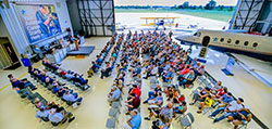 Looking down on the aviation graduation ceremony inside the Mason Jewett Airport