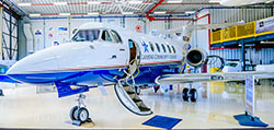 Aviation Technology Jet sits in the Mason Jewett Airport hanger with its door open