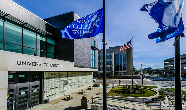 LCC flags fly outside of the University Center entrance