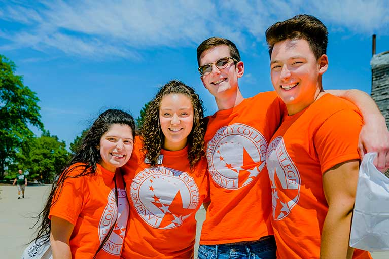 a group of freshman students wearing orange LCC branded shirts