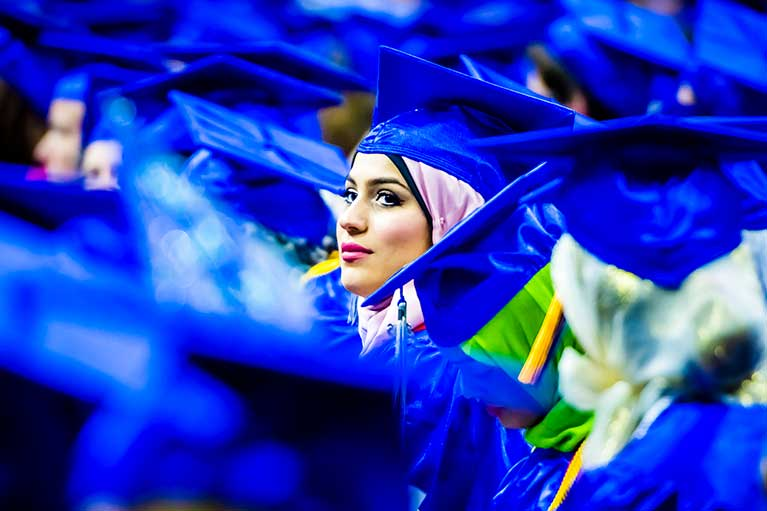 an lcc student wearing her hijab and graduation cap at commencement