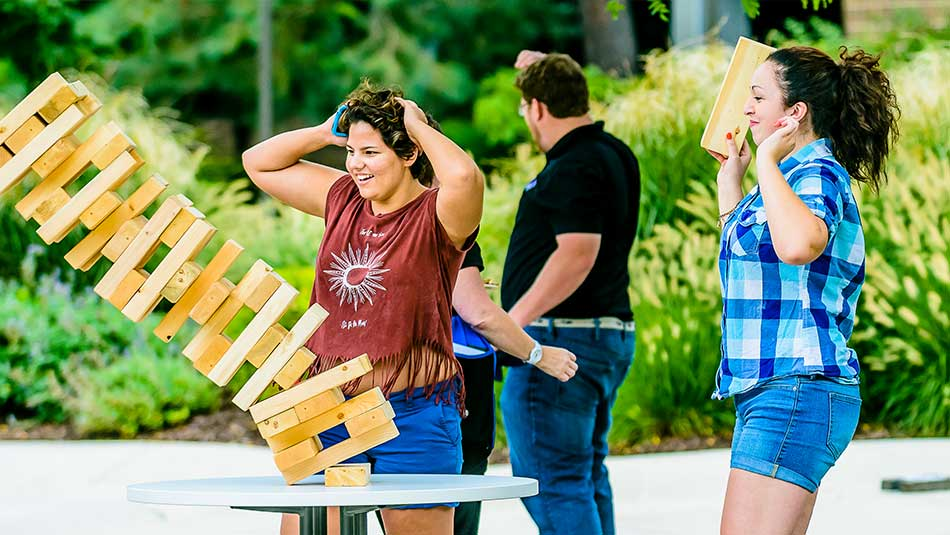 Students play giant jenga