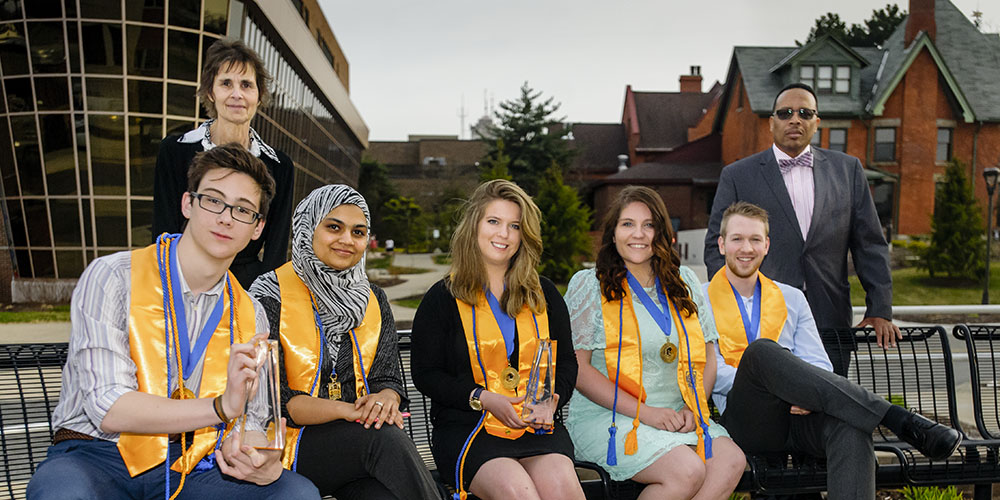 Students show their awards as phi theta kappa members