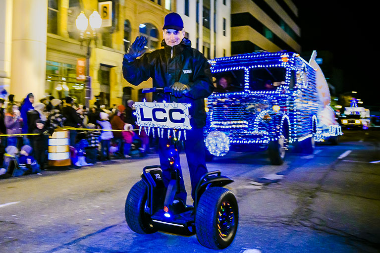 LCC's President, Dr. Brent Knight. rides a segway in the 2015 Silverbells in The City Parade