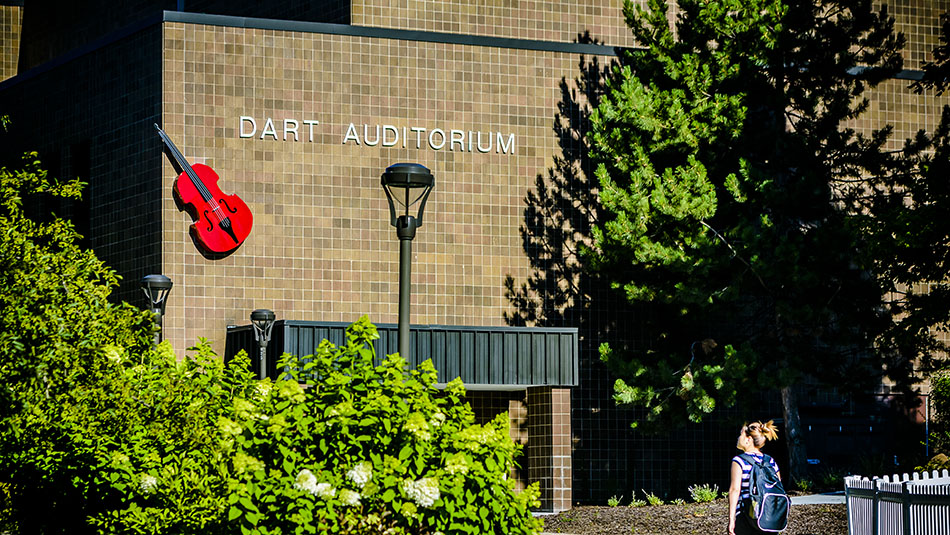 A student walks by the entrance to the Dart Auditorium