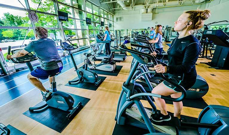 woman riding elptical at west campus fitness center