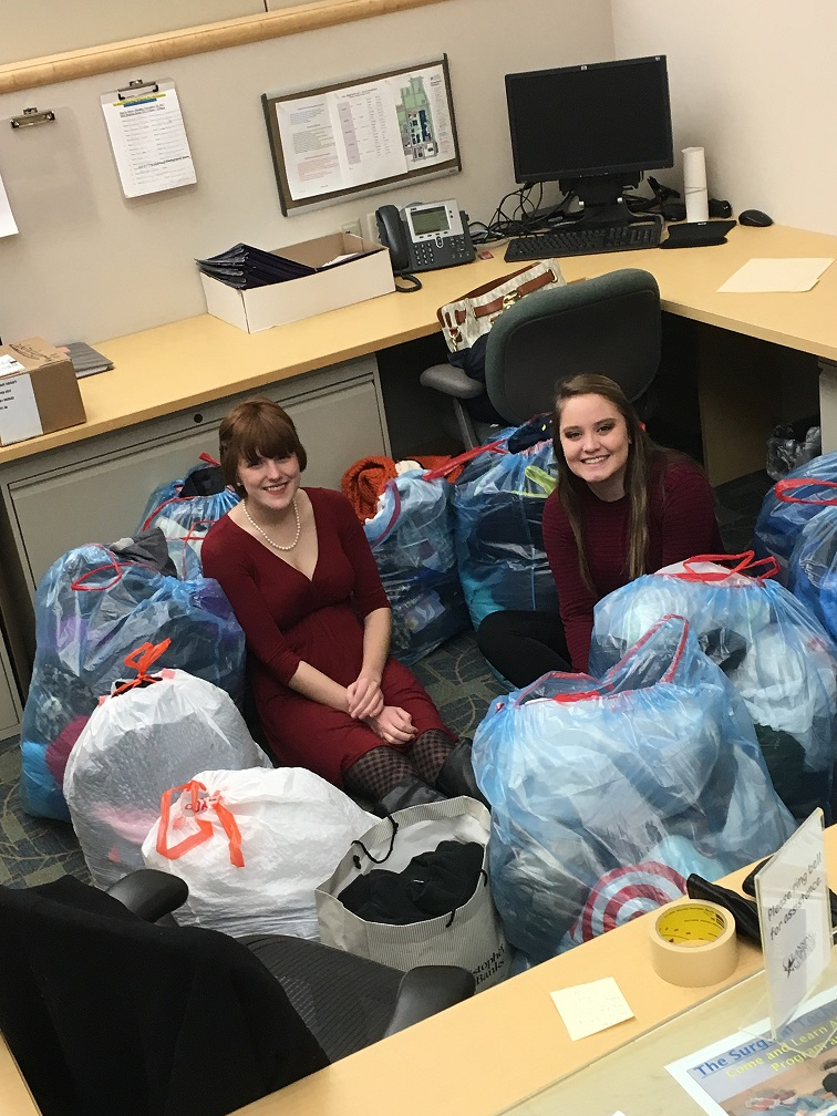 Employees with bags of coats