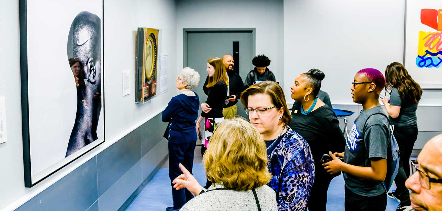 People exploring the Mott-Warsh Art Collection