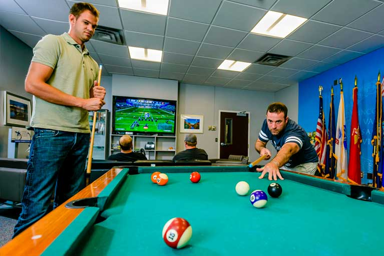 veteran students playing pool in resource center