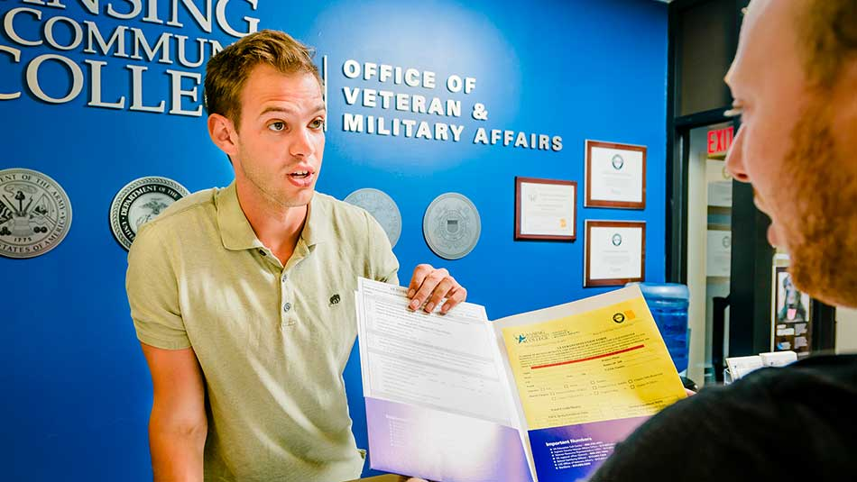 Advisor explains paperwork at the Office of Veteran & Military Affairs